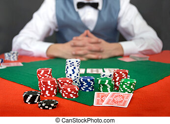 Poker tilt - A poker player focussing on his chips and...