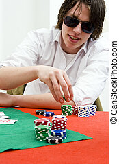 Full tilt poker player - A pker player with huge sunglasses,...