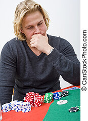 Poker decision - A man trying tomake a decision on his...