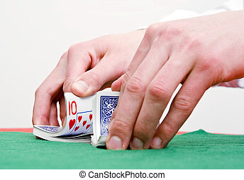 Shuffling cards - Dealers hands shuffling cards during a...