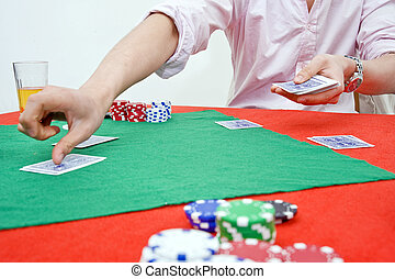 Dealing cards - A man dealing cards during a poker game