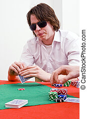 Poker player - A poker player looking at his cards, obsucred...