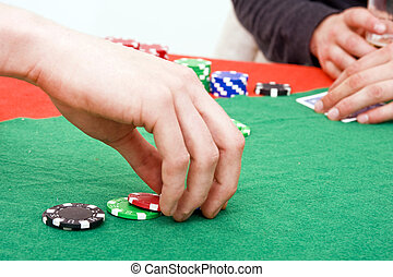Raising bets - A poker player raising the bet on his game