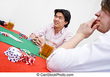 Poker game - An Asian man sittingat the poker table during a...