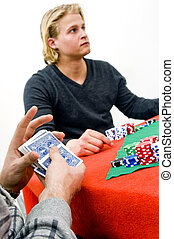 Shuffling Poker Cards - A card player shuffling cards during...