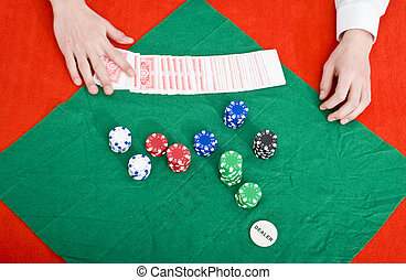 Poker wipe out - A dealer at a poker table preparing a new...