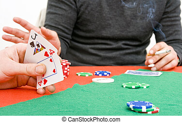 Poker game play - Two poker playersduring a game, looking at...