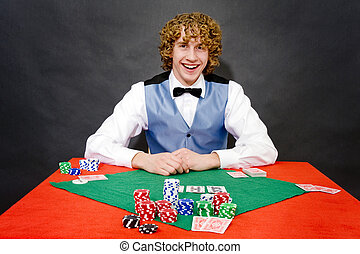Smiling poker dealer - A smiling poker dealer, ready for a...