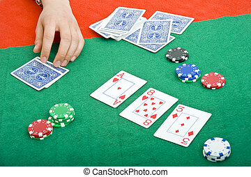 Poker game - Chips, cards, and the flop during a poker game