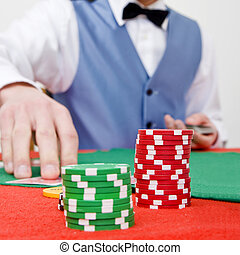 Stack of chips - Two stacks of poker chips on a table with a...