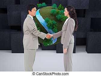 Composite image of side view of hand shaking trading partners