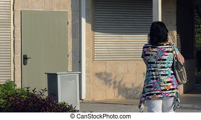 Self defence spray in use - Woman is using self defence...