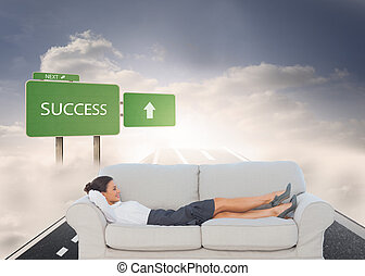 Composite image of smiling business woman lying down on the...