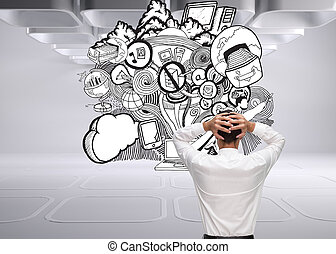 Composite image of businessman standing back to camera hands...