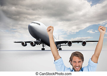Composite image of happy man celebrating success with arms...