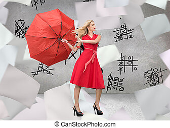 Composite image of elegant blonde holding umbrella -...