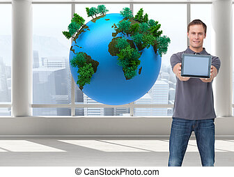 Composite image of young man showing screen of his tablet...