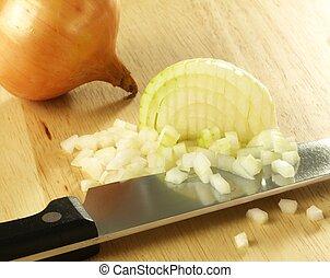 Onion - Chopped onion on cutting board