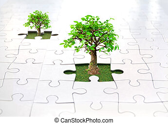 Jigsaw puzzle tree - Small trees growing from grass inside a...