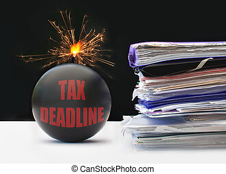 Tax deadline - Exploding bomb labeled tax deadline next to a...