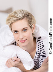 Beautiful young woman having a lazy day - Beautiful young...