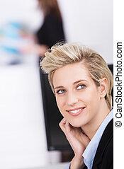 Businesswoman sitting thinking or watching