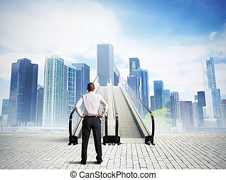Stairs to success - Businessman in front of a stairs to...