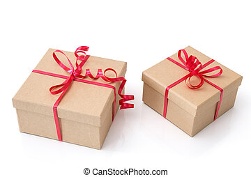 Two gift boxes with red ribbons on white background