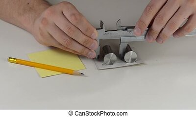 Measuring with calipers - Measure and record dimensions with...