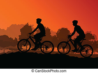 Active cyclists bicycle riders in wild forest nature...