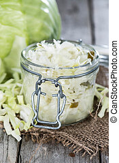 Portion of Coleslaw on wooden background