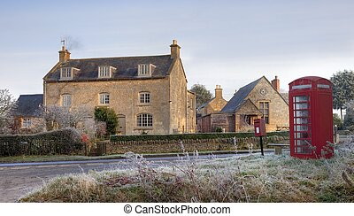 Cotswold village in winter - Cotswold village with early...