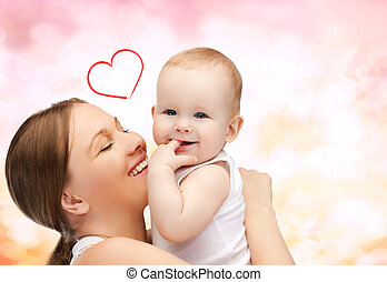 happy mother with adorable baby - family, children,...