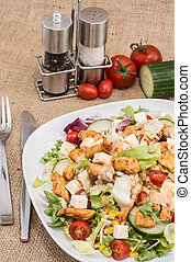 Big Salad with Chicken and Cheese on brown background