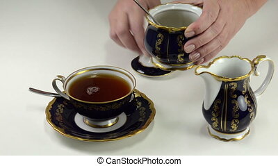Brown sugar to tea cup - Someone adds the brown sugar to tea...