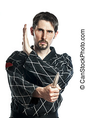 Self defense exercise with knife - Man in combat dress do a...