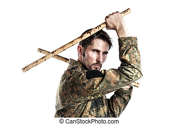 Self defense instructor with bamboo sticks - Male self...