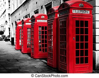 Traditional british red phone booths in a row