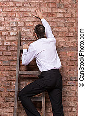 Man up against a brick wall - Man at the end of his search...