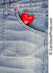Red heart in jeans trousers pocket