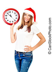 young girl in christmas hat showing clock