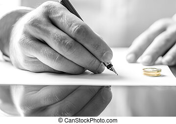 Signing divorce paper - Closeup of male hand signing divorce...