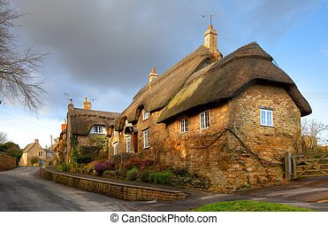 Thatched stone cottage, England - Cotwold thatched stone...
