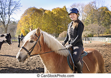 Young girl riding horse - Portrait of teenage girl riding...