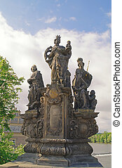 Ancient sculpture on the Charles Bridge Prague St Barbara,...