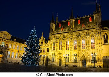 Illuminated Christmas tree on a Burg square in Bruges,...