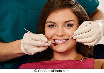 Young brunette woman at dentist's surgery close-up
