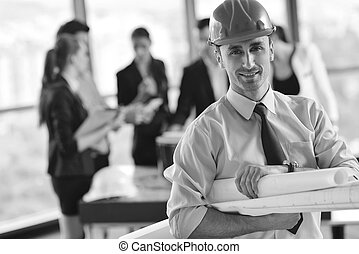 business people and construction engineers on meeting -...