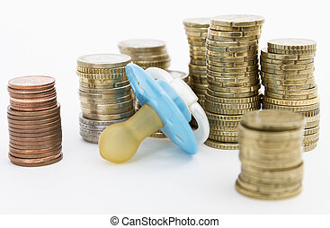 pacifier with hard money in light background