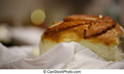 New-baked loaf of bread. - Close-up of female hand taking a...